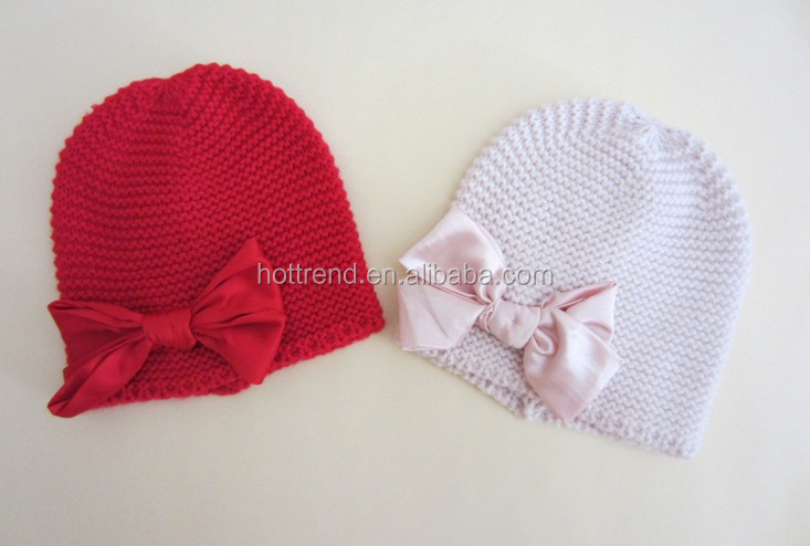 Acrylic reverse knit beanie with satin bow on side