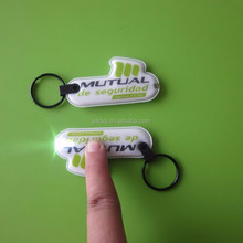 Cheap personalized customized pvc squeeze led light key tag / key holder