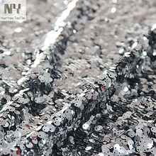 Nanyee Textile Fancy Allover Turnable Silver Metallic Fabric For Dress