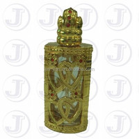 Sweeet Heart and Cute Flower Metal and Full of Shiny Red Jewlry Decoration Covered on the Royal Arabian Perfume Oil Glass Bottle