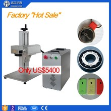 Wuhan Huahai YAG/diode /UV/Green / fiber laser marking machine price for date code text engraving with red preview rotation
