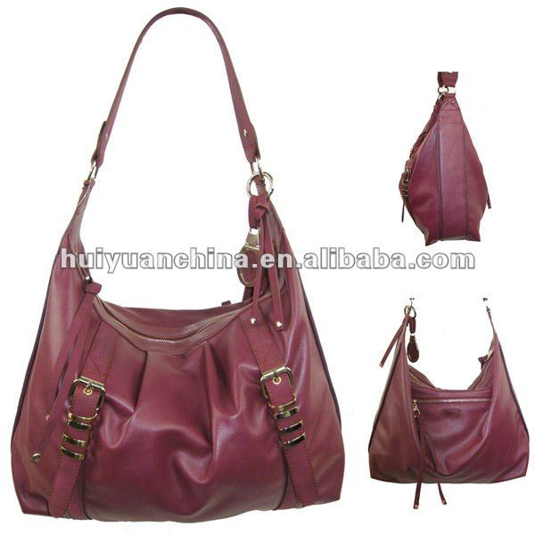 luxurious ladies long strap hobo bag with many metal details