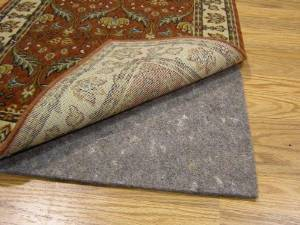 Durable, Reversible 5' X 8' PREMIER HOLD(TM) Rug Pad for Hard Surfaces and Carpet