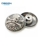 Antique silver tone metal shank jeans button with customized skull logo embossed