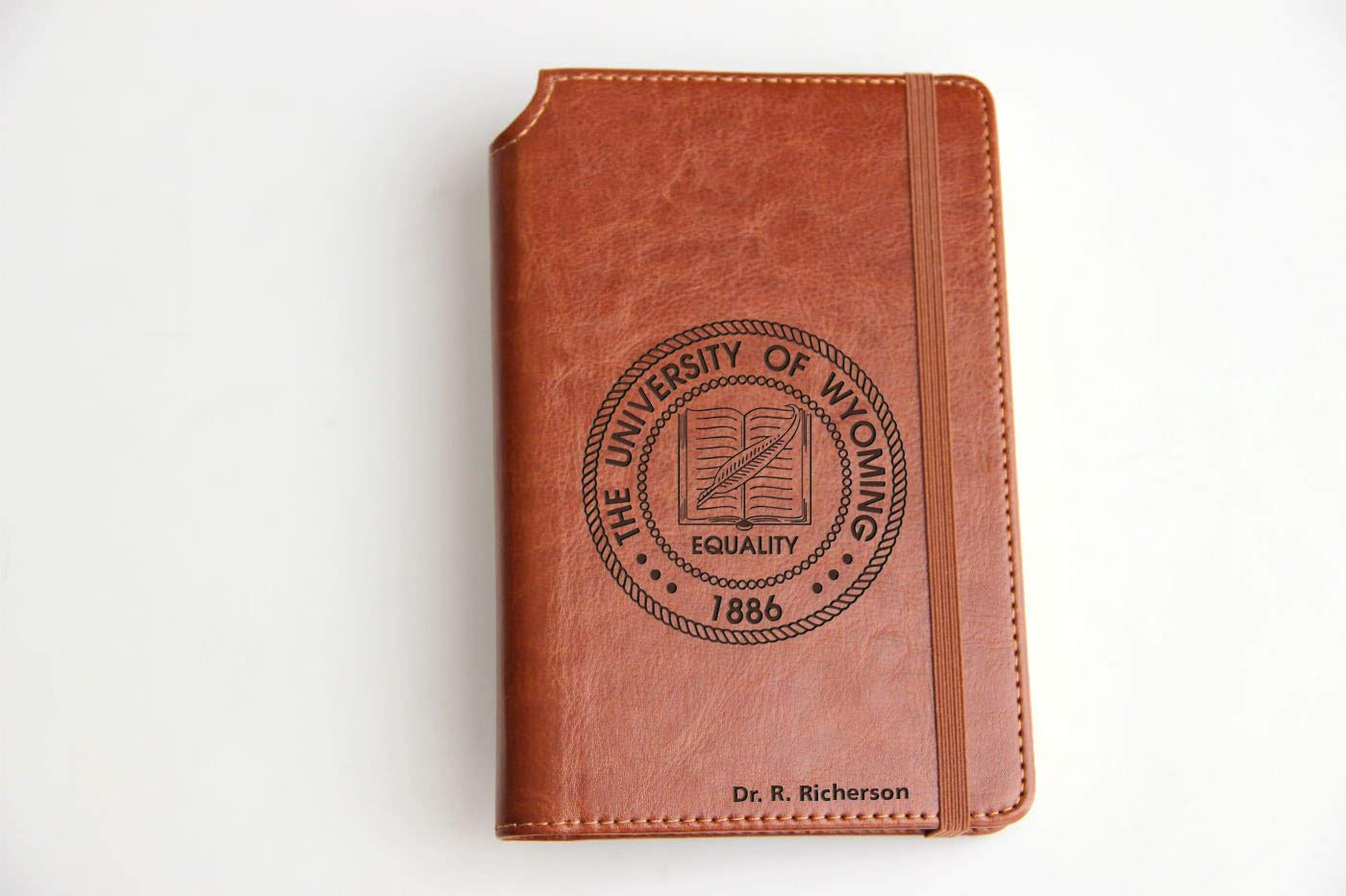 Customizable laser engraved University of Wyoming seal Journal Customizable engraved Journal leather bound, strip with the same color to keep it closed