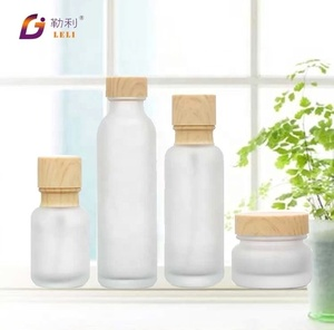 Luxury glass cosmetic bottle lotion pump bottle cylinder glass cosmetic container and packaging
