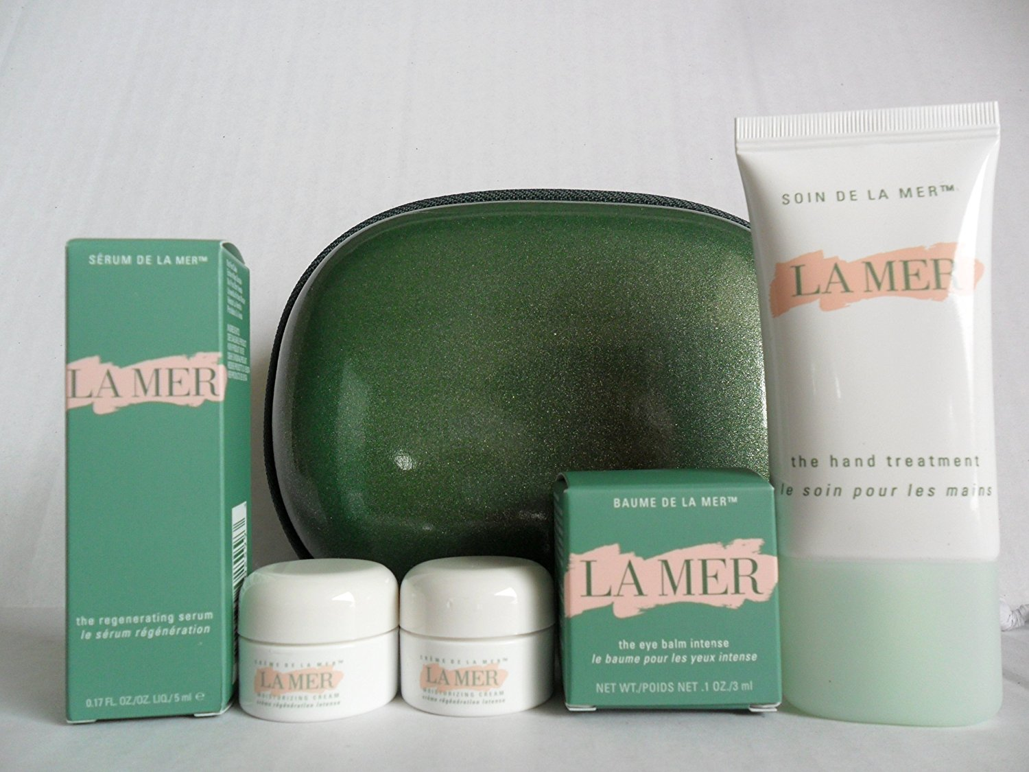 La Mer Gift Set: The Moisturizing Cream .1 oz x 2 jar = .24 oz + The Eye Concentrate .1 oz / 3ml + The Regenerating Serum .17 oz / 5ml + The Hand Treatment 1 oz / 30ml Tube + Cosmetic Clam Shell Case. This is Promotional Sample Size Set.