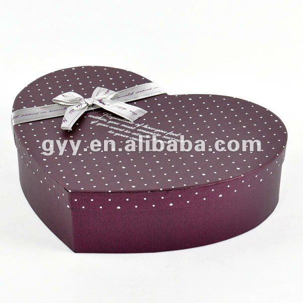 Mysterious purple spotty paper gift box/packaging box with silver bow