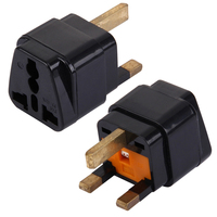 Universal plug adapter with fuse for United Kingdom, Hong Kong, the Middle East, Singapore, Malaysia