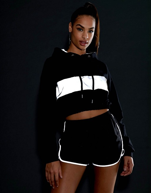 KY black two pieces set Drawstring hood Dropped shoulders Reflective panel Ribbed trims DESIGN hoodie crop length and hot shorts