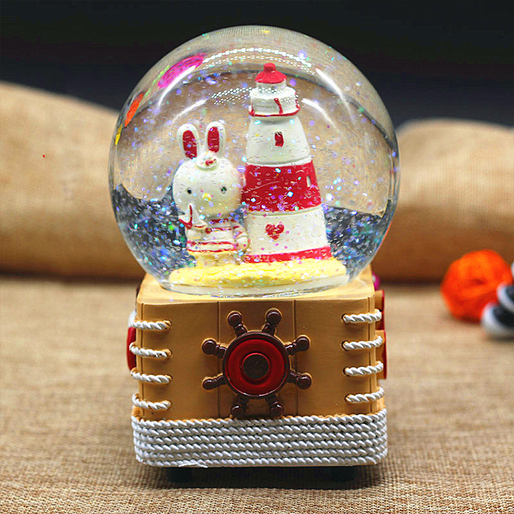 Promo custom made color glitter souvenir man and woman lover snow globe with resin base