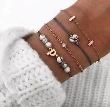 Европейские и американские браслеты, новый креативный браслет с инкрустированным бриллиантом и бусинами, с кисточками, костюм из четырех п...(Китай)