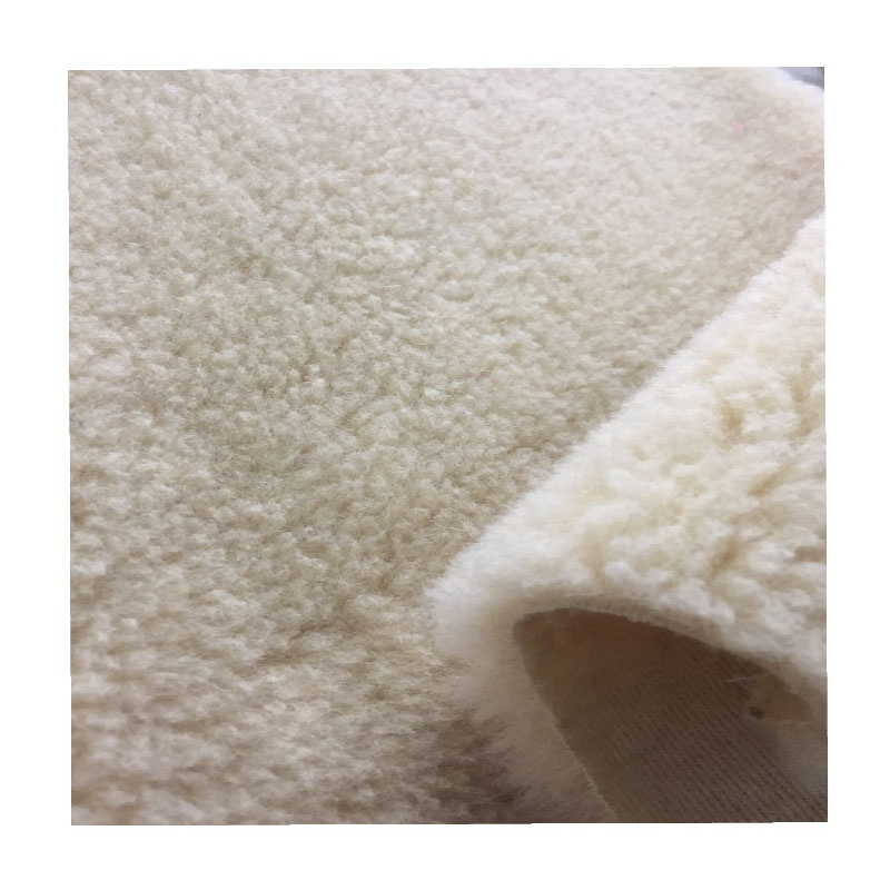 The hair is 100% wool bottom is polyester weft knitting faux lamb fur sherpa wool fabric