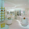 Brand cosmetic perfume store display fixture and counter with brand Backlit LOGO