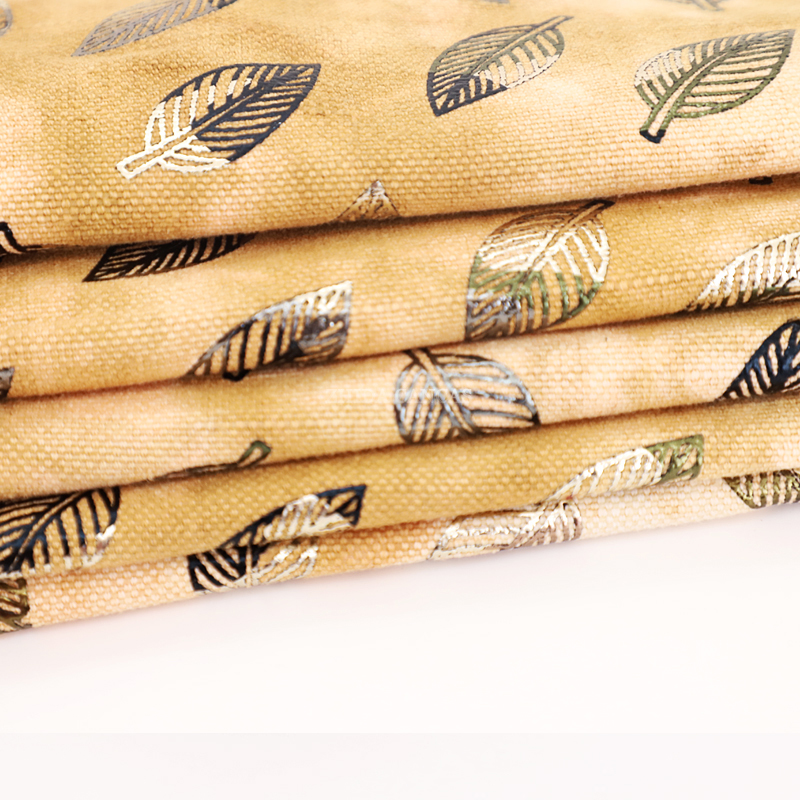 Factory online store 1 MOQ wholesale cheap leaf pattern bronzing fabric for bags