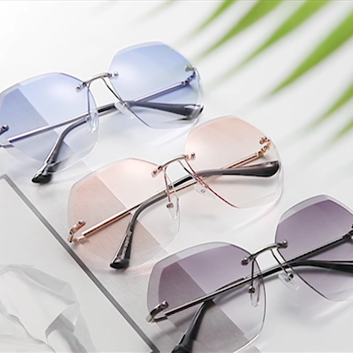 2020 UV400 Oversized Ocean Lens Shades Sun Glasses China Factory Wholesale Women Female Lady Rimless Sunglass