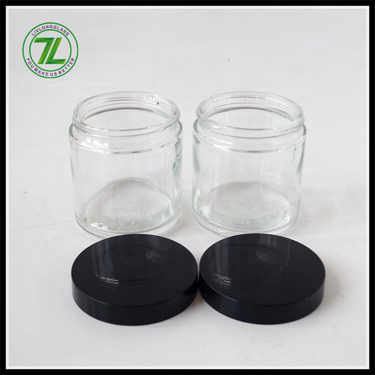 straight slide clear round glass jar for weeds herbs skin cream bottle with black matte or smooth screw lid 2oz 3oz 4oz