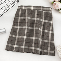 Autumn dress 2019 new Korean version of the retro college style high waist Plaid half-length skirt slim anti-slippery buttock A-