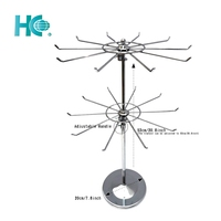 Adjustable wire rotating floor display stand