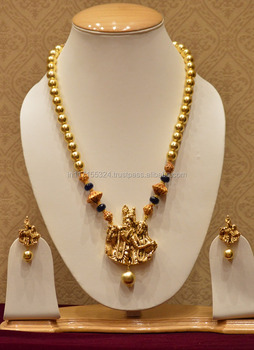 b750be128 Golden pearls necklace set temple jewellery with radha-krishna figure