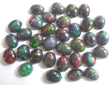 Top AAA Quality Natural Black Ethiopian Opal With Play Of Fire 5.50x7.50mm Oval Cabochon Loose Gemstone