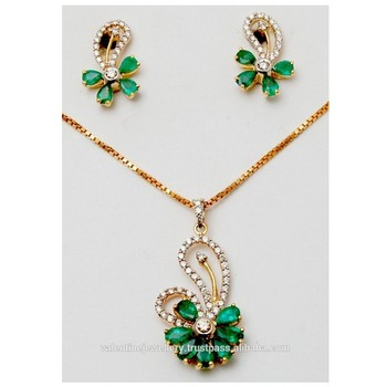 Exclusive gold emerald pendant set buy gold diamond pendant sets exclusive gold emerald pendant set aloadofball Gallery