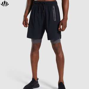 Breathable perforated panel split hem training men shorts with compressive base layer