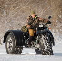 Barchan off-road vehicle tricycle all-terrain vehicle sand dunes deep snow amphibian two passengers tourist walks