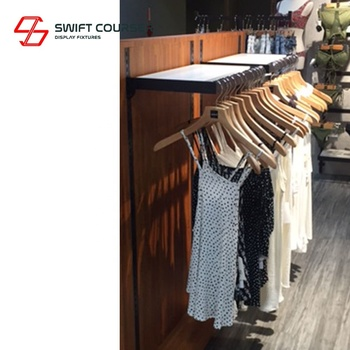 Fixture metal wood clothing slat wall display