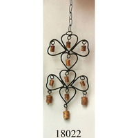 Small cluster of cow bells handmade wrought iron craft wind chimes