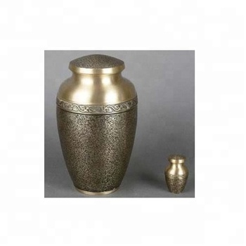 Metal cremation urn with etching and band engraving