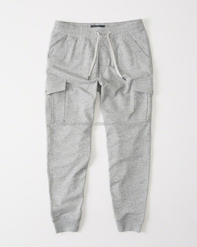 Soft cotton joggers with cargo pocket details, drawcord adjustment waistband, ribbed cuffs
