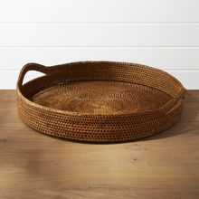 Round rattan serving tray with honey brown colors