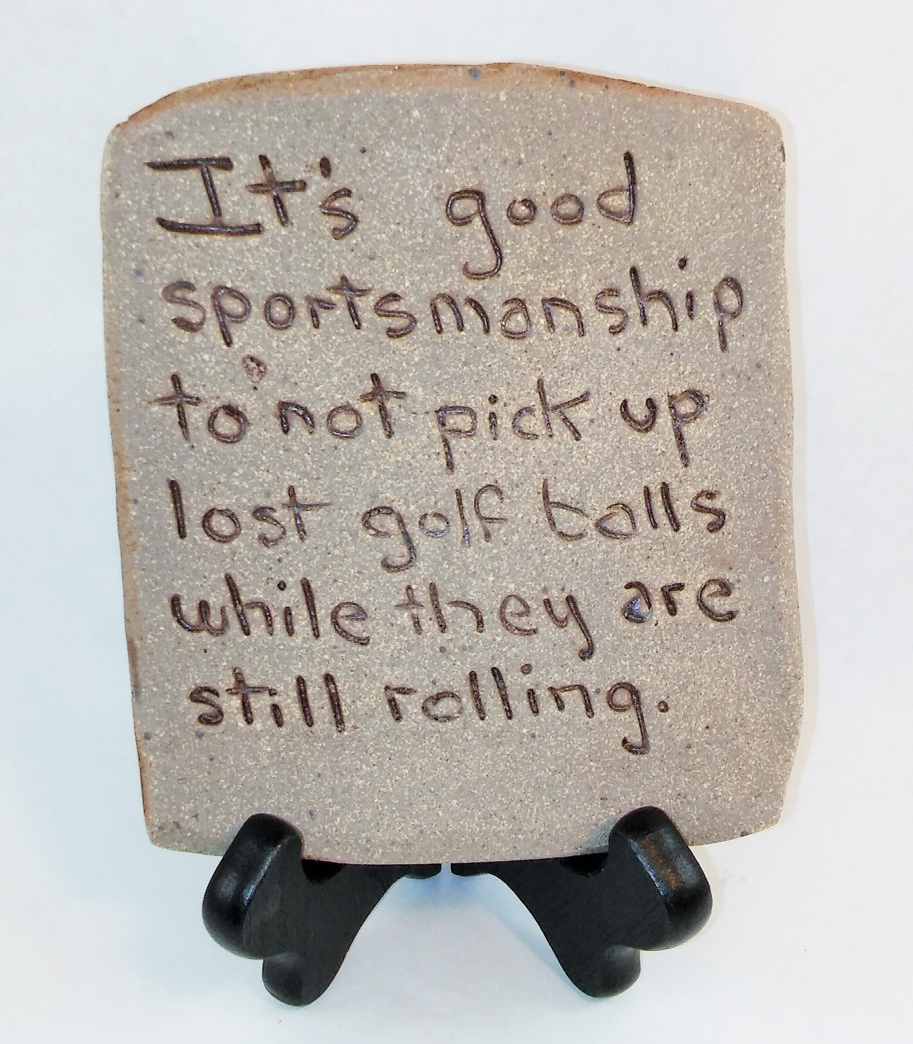 "Aunt Chris' Pottery - Desk Top - Rustic Clay Sign - With Unique Biblical Words Or Quotes ""It's good sportsmanship to not pick up lost golf balls while they are still rolling."" - Sits On Wood Easel"
